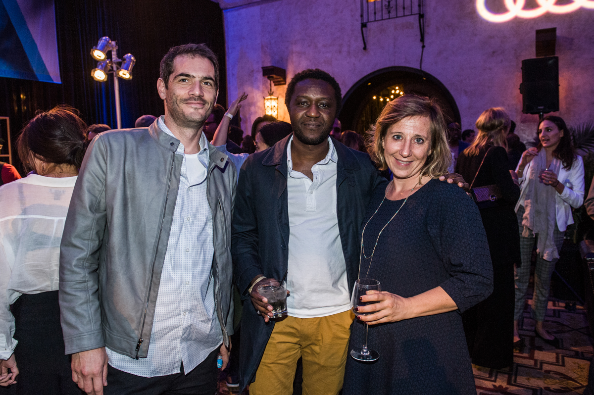 (L to R) Guest; Daouda Coulibaly (Director, WÙLU); Severine Madinier (Executive Director, French Film &TV Office) at ELLE after-party